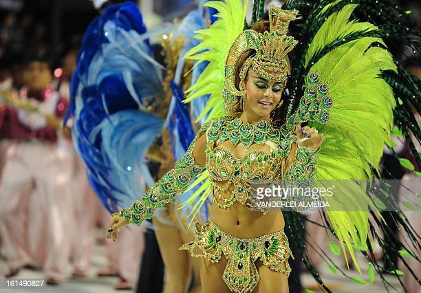 A reveler of Sao Clemente samba school performs during the second night of Carnival parade at the Sambadrome in Rio de Janeiro on February 11 2013...