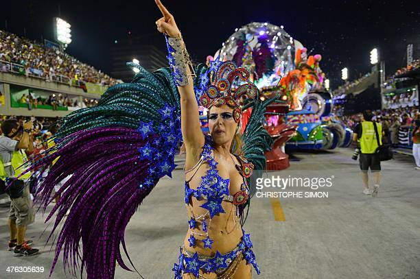 A reveler of the Grande Rio samba school performs during the first night of carnival parade at the Sambadrome in Rio de Janeiro on March 2 2014 AFP...