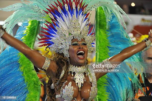 A reveler of the Inocentes de BelfordRoxo samba school performs during the first night of Carnival parade at the Sambadrome in Rio de Janeiro on...