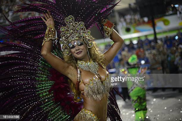 A reveler of Uniao da Ilhia samba school performs during the first night of Carnival parade at the Sambadrome in Rio de Janeiro on February 11 2013...
