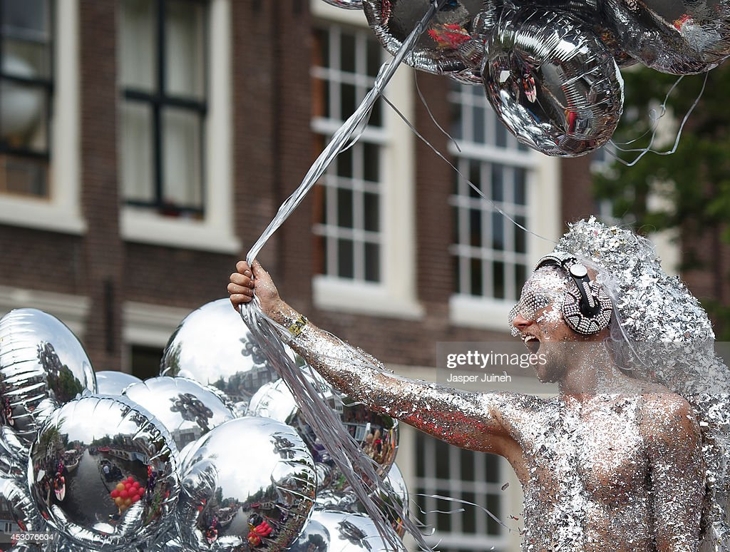 A reveler on a boat covered in glitters parades the Prinsengracht canal participating in the Amsterdam Canal Parade during Amsterdam Gay Pride on August 2, 2014 in Amsterdam, Netherlands. Over 500,000 people from all over the world attend the yearly Gay Pride and the Canal Parade where 79 boats with revelers in fancy comstumes parade the Dutch capital from the Prinsengracht canal to the Amstel river.