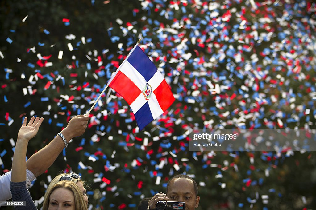 A reveler on one of the Duck Boats in the parade waved a Dominican Republic flag. Designated hitter David Ortiz is Dominican. Red Sox fans lined Boylston Street near Boston Common on Nov 2, 2013 during the Red Sox's Rolling Rally to celebrate winning the 2013 World Series.