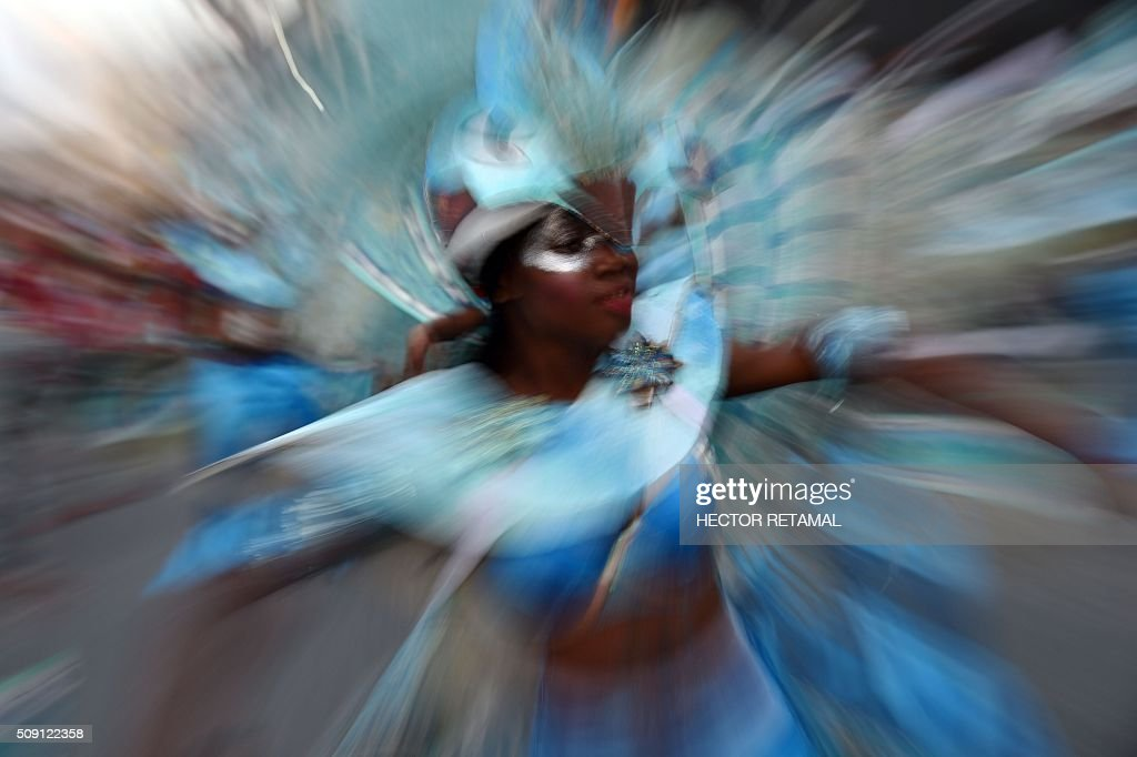 A reveler performs during of 2016 National Carnival Parade on February 9, 2016 in Port-au-Prince, Haiti. The name in Haitian creole of the carnival for this year is 'Ayiti Toutan' (Haiti Always). The launch of the carnival the previous day was suspended tdue to the political situation affecting Haiti. / AFP / HECTOR RETAMAL