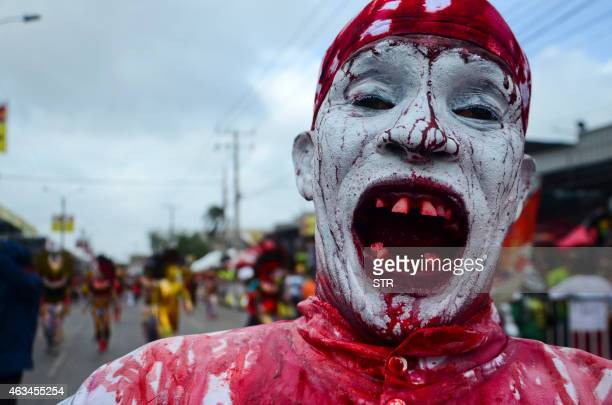 A reveler performs during the carnival parade in Barranquilla Colombia on February 14 2015 Barranquilla's Carnival a tradition created by locals at...