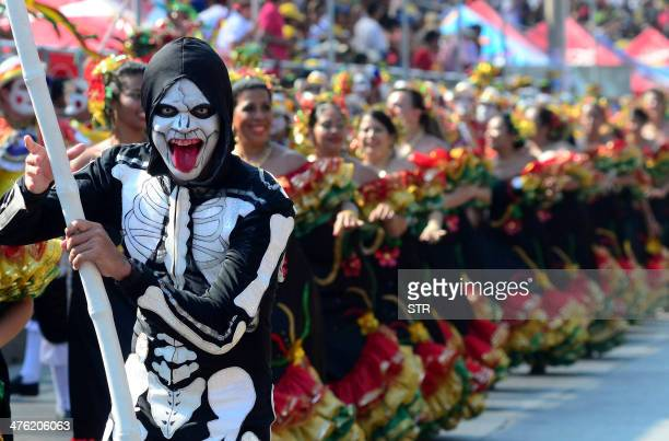 A reveler performs during the carnival parade in Barranquilla Colombia on March 2 2014 Barranquilla's Carnival a tradition created by locals at the...