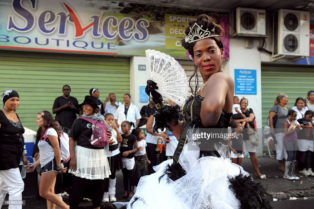 A reveler poses during an 'Ash Wednesday' carnival parade in Fort-de-France on the French Caribbean island of Martinique, on February 13, 2013.