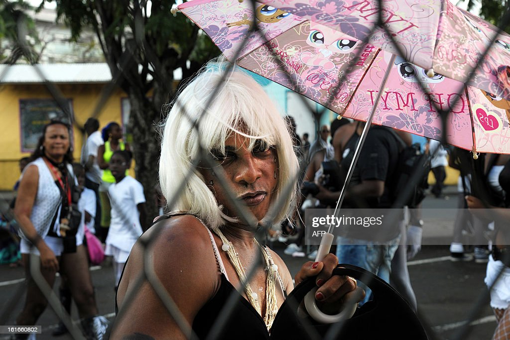 A reveler poses during an 'Ash Wednesday' carnival parade in Fort-de-France on the French Caribbean island of Martinique, on February 13, 2013. AFP PHOTO/ JEAN-MICHEL ANDRE