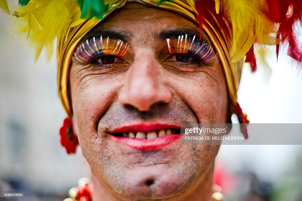 A reveler poses during the annual carnival parade in Torres Vedras on February 9, 2016. The Torres Vedras Carnival is allegedly the 'most Portuguese' of all the carnivals in the country recognized by the strong political and football satire of the revelers disguises and their floats. / AFP / PATRICIA DE MELO MOREIRA