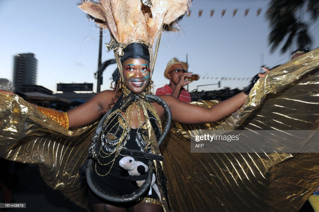 A reveler poses during the Carnival parade in the streets of Fort-de-France on the French Caribbean island of Martinique, on February 10, 2013. The Carnaval started on February 9, 2013 and will run until Ash Wednesday on February 13, 2013 when Vaval, a giant papier-mache figure symbolizing the king of the carnival, is burned.