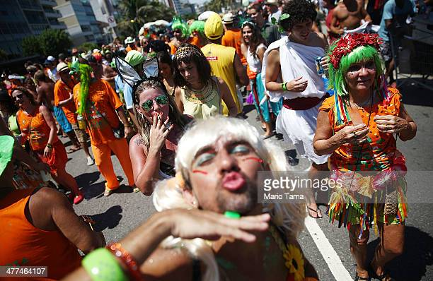 A reveler poses while celebrating during a street carnival 'bloco' on March 9 2014 in Rio de Janeiro Brazil While Carnival officially ended earlier...