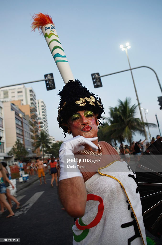 A reveler poses with an Olympic torch as a headdress during Carnival celebrations at the Banda de Ipanema bloco, or street parade, on February 9, 2016 in Rio de Janeiro, Brazil. Festivities have continued throughout major Brazilian cities for Carnival in spite of the threat of the Zika virus. Today is the last official day of Carnival.