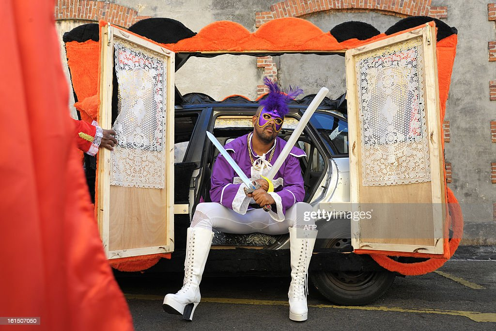 A reveler sits in a decorated car prior to take part in the Carnival parade in the streets of Fort-de-France on the French Caribbean island of Martinique, on February 11, 2013. The Carnaval started on February 9, 2013 and will run until Ash Wednesday on February 13, 2013 when Vaval, a giant papier-mache figure symbolizing the king of the carnival, is burned.