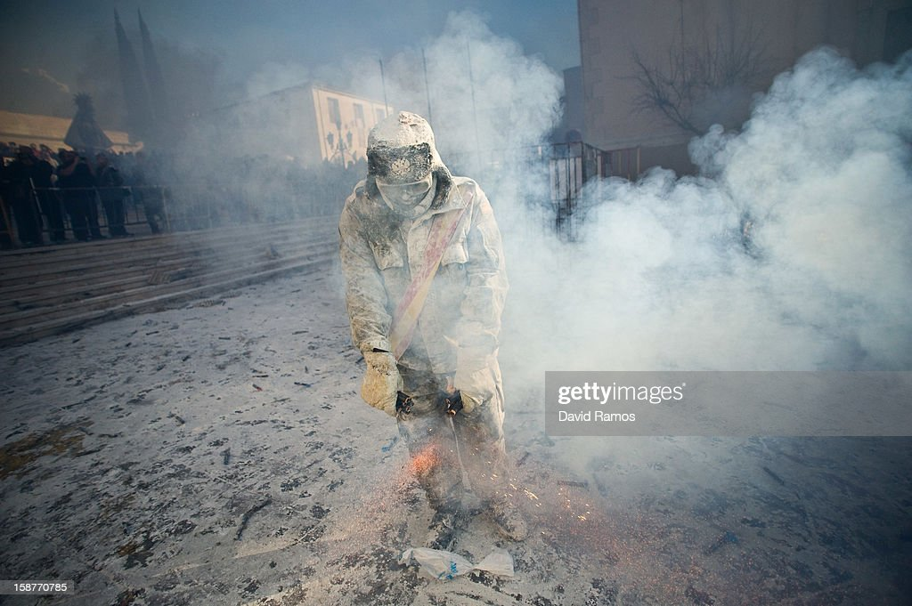 A Reveler takes part in the battle of 'Enfarinats', a flour fight in celebration of the Els Enfarinats festival on December 28, 2012 in Ibi, Spain. Citizens of Ibi annually celebrate the festival with a battle using flour, eggs and firecrackers. The battle takes place between two groups, a group of married men called 'Els Enfarinats' which take the control of the village for one day pronouncing a whole of ridiculous laws and fining the citizens that infringe them and a group called 'La Oposicio' which try to restore order. At the end of the day the money collected from the fines is donated to charitable causes in the village. The festival has been celebrated since 1981 after the town of Ibi recovered the tradition but the origins remain unknown.