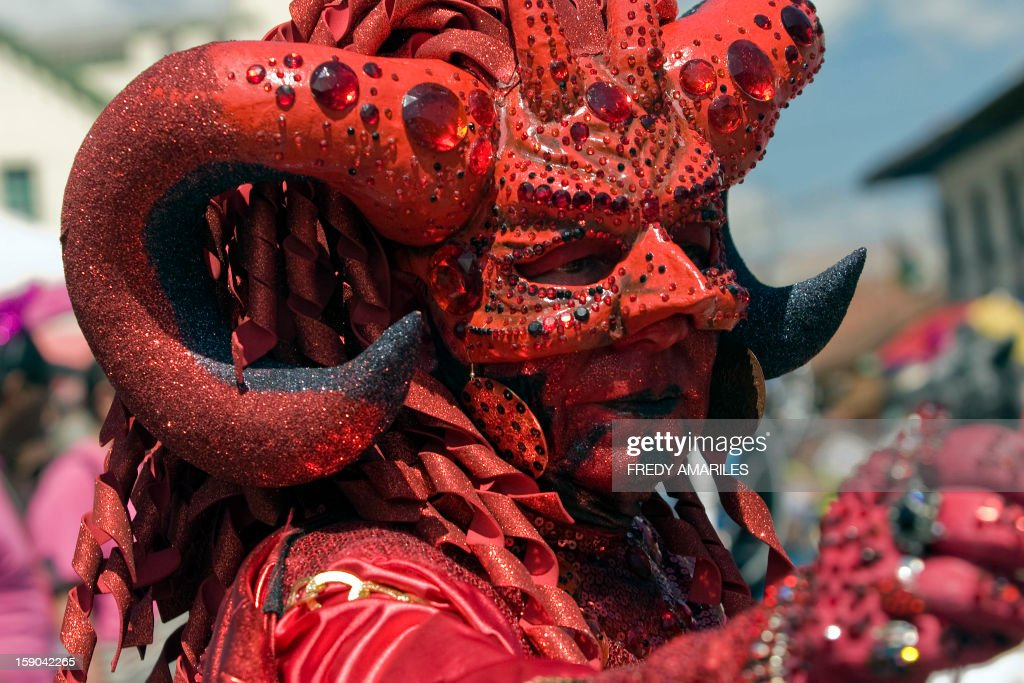 A reveler takes part in the Devil's Carnival in Riosucio, Caldas department, Colombia, on January 6, 2013. Riosucio's Carnival was proclaimed by UNESCO as a cultural intangible heritage and takes place every two years. AFP PHOTO/Fredy AMARILES