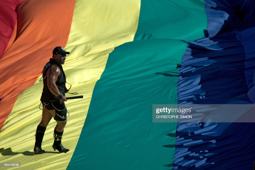 A reveler takes part in the gay pride parade at Copacabana beach in Rio de Janeiro, Brazil on October 13, 2013.