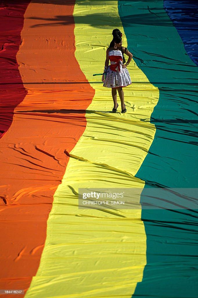 A reveler takes part in the gay pride parade at Copacabana beach in Rio de Janeiro, Brazil on October 13, 2013.