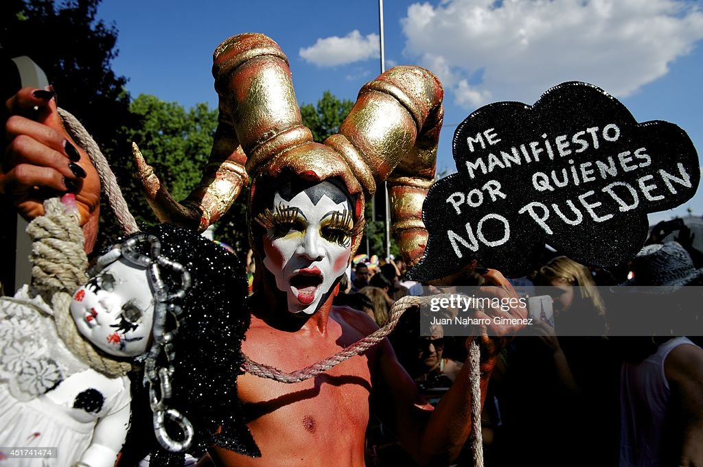 A reveler takes part in the Gay Pride Parade in Madrid on July 5, 2014 in Madrid, Spain. State Protest LGBT Pride 2014 this year has the theme 'Nos Manifestamos Por Quienes No Pueden' (We march for those who can not) After last week held most of the demonstrations outside Madrid, the communities around the country come together to pool their efforts in the biggest Pride of Europe.