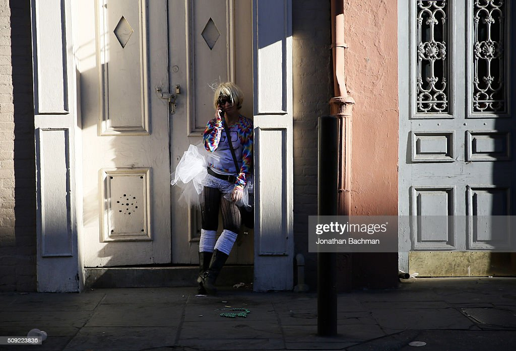 NEW ORLEANS, LOUISIANA - FEBRUARY 9, 2016: A reveler talks on her phone during Mardi Gras day on February 9, 2016 in New Orleans, Louisiana. Fat Tuesday, or Mardi Gras in French, is a celebration traditionally held before the observance of Ash Wednesday and the beginning of the Christian Lenten season.