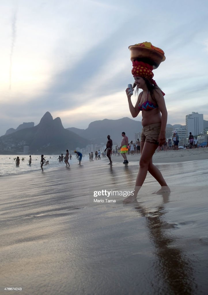A reveler walks on Ipanema Beach during the Banda de Ipanema street carnival bloco on March 4, 2014 in Rio de Janeiro, Brazil. Carnival is the grandest holiday in Brazil, annually drawing millions in raucous celebrations.