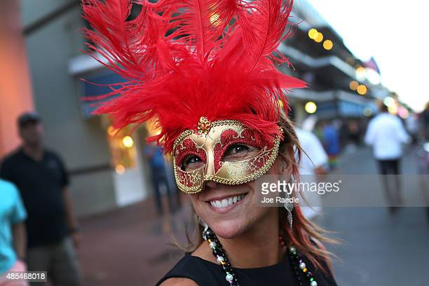 A reveler wears a mask in the French Quarter on August 27 2015 in New Orleans Louisiana Tourists have returned as the town prepares to honor the...