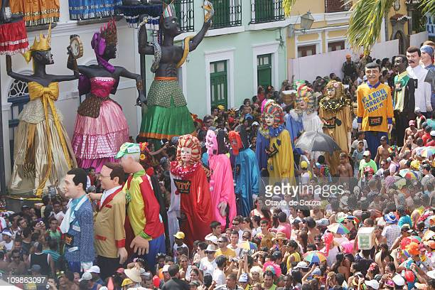 Revelers and the traditional giant dolls take over the streets of the historical center during the carnival celebrations on March 8 2011 in Olinda...