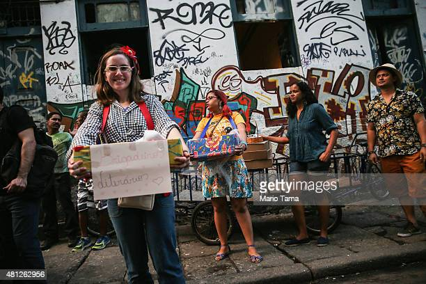 Revelers and vendors gather during a 'Festas Juninas' marching performance by the street band 'Monobloco' on July 18 2015 in Rio de Janeiro Brazil...