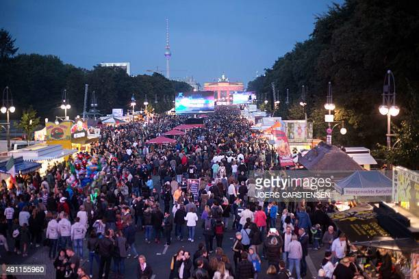 Revelers attend celebrations of the Day of the German reunification near the Brandenburg gate in Berlin on October 3 2015 Germany celebrates the...