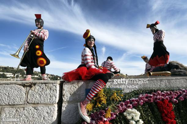 Revelers attend the traditional 'battle of flowers' carnival event on February 15 in VillefranchesurMer southeastern France / AFP / VALERY HACHE