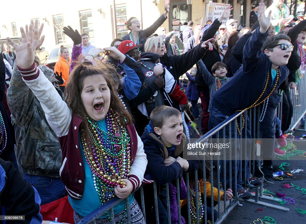 Revelers call for throws during the Gulf Coast Carnival Association Mardi Gras Parade in Biloxi, Miss., on Tuesday, Feb. 9, 2016. Three parades rolled in South Mississippi on Fat Tuesday, the last day of carnival season, celebrated before the beginning of Lent.