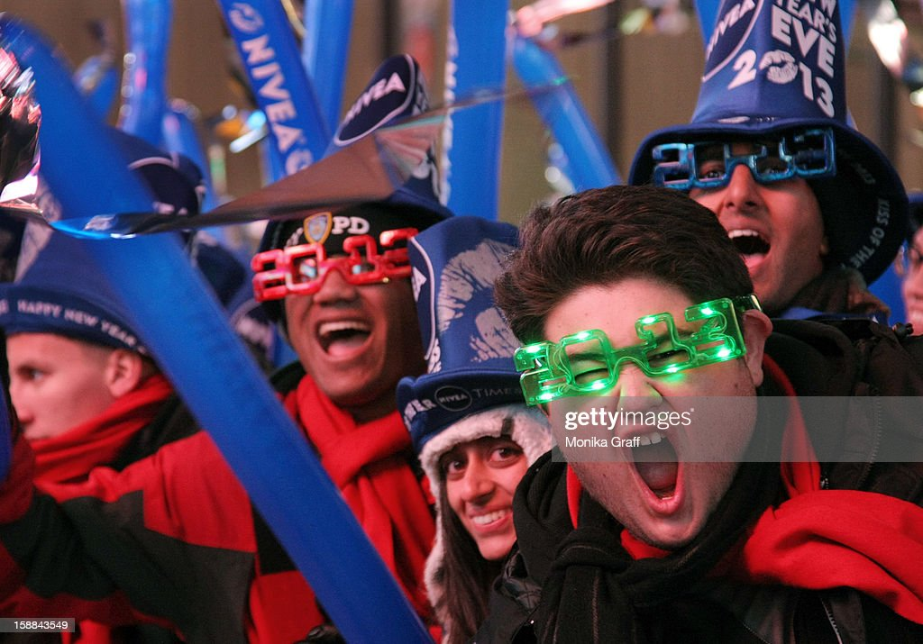 Revelers celebrate as hundreds of thousands of people gather in Times Square on New Year's Eve on December 31, 2012 in New York City. Approximately one million people are expected to ring in the new year in Times Square.