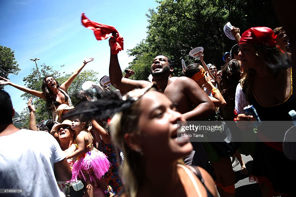 Revelers celebrate at a 'bloco' street party during pre-Carnival festivities on February 23, 2014 in Rio de Janeiro, Brazil. Carnival officially begins on February 28 but pre-festivities have already begun. Brazil is gearing up to host the 2014 FIFA World Cup.