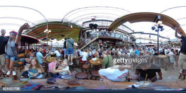 Revelers celebrate at the Bierkoenig beer hall near the Ballermann stretch on July 27 2017 in Palma de Mallorca Spain The term Ballermann which...