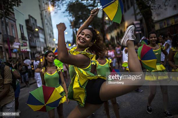 Revelers celebrate during a street parade ahead of Rio's 2016 Carnival in Rio de Janeiro Brazil on Saturday Jan 16 2016 The Carnival runs from Feb 5...