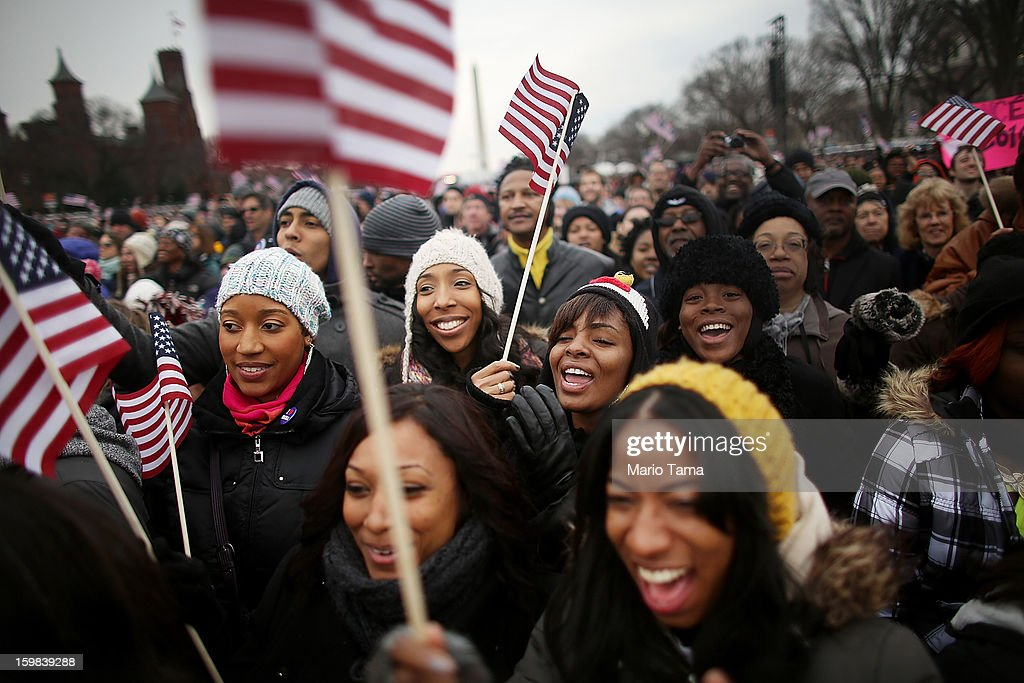 Revelers celebrate in front of the Washington Monument near the U.S. Capitol building on the National Mall while attending the public Inauguration ceremony on January 21, 2013 in Washington, DC. U.S. President Barack Obama was ceremonially sworn in for his second term today.