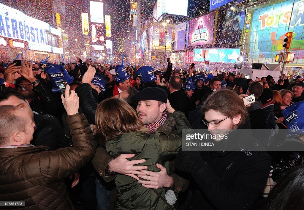 Revelers celebrate the New Year January 1, 2011 in New York's Times Square after watching the traditional ball drop. AFP PHOTO/Stan HONDA