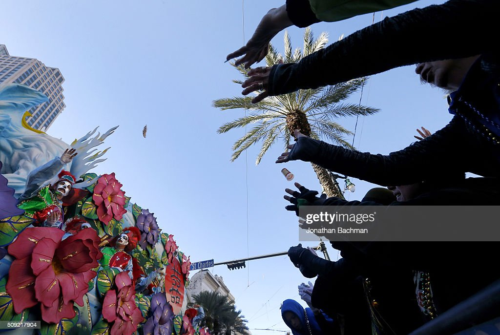 Revelers cheer for beads during Mardi Gras day on February 9, 2016 in New Orleans, Louisiana. Fat Tuesday, or Mardi Gras in French, is a celebration traditionally held before the observance of Ash Wednesday and the beginning of the Christian Lenten season.