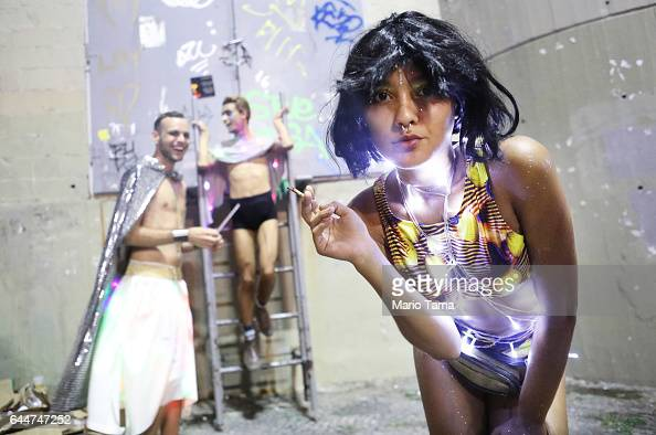 Revelers clown around and pose at the 'LED is My Light' street party in the early morning hours at the beginning of Carnival on February 24 2017 in...