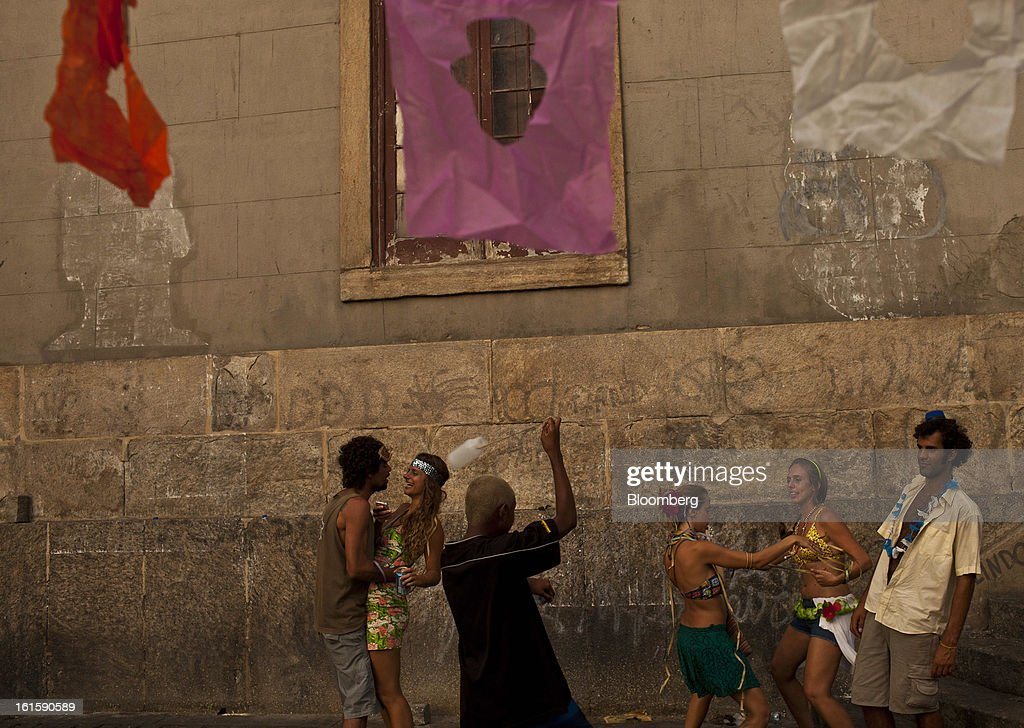 Revelers dance at a street party during Carnival in downtown Rio de Janeiro, Brazil, Monday, Feb. 11, 2013. The festivities, which are expected to attract almost 900,000 visitors, precede the start of Lent, which begins with Ash Wednesday on Feb. 13. Photographer: Dado Galdieri/Bloomberg via Getty Images