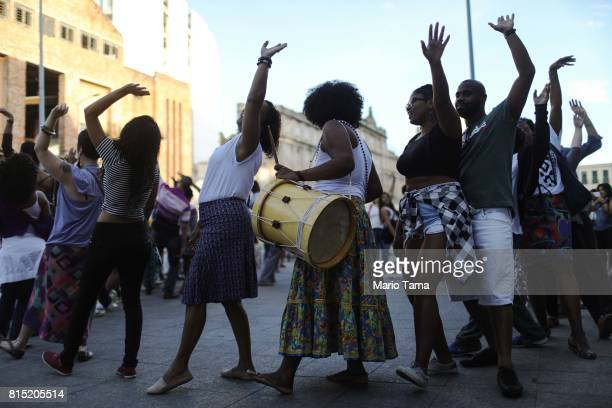 Revelers dance at an AfroBrazilian festival held next to the Valongo slave wharf entry point in the Americas for nearly one million African slaves on...
