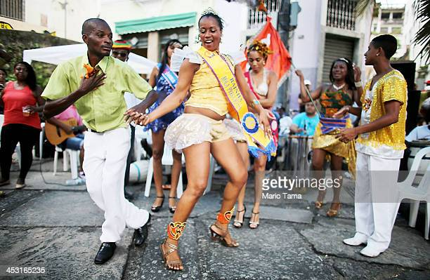 Revelers dance at National Day of Samba celebrations at Pedra do Sal in the port district on December 2 2013 in Rio de Janeiro Brazil Samba is...