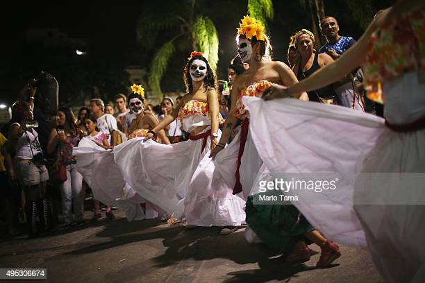 Revelers dance during a Day of the Dead party on November 1 2015 in Rio de Janeiro Brazil Brazilians often mark the traditional Mexican holiday by...