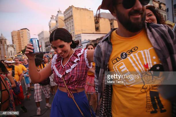 Revelers dance during a 'Festas Juninas' marching performance by the street band 'Monobloco' on July 18 2015 in Rio de Janeiro Brazil 'Festas...