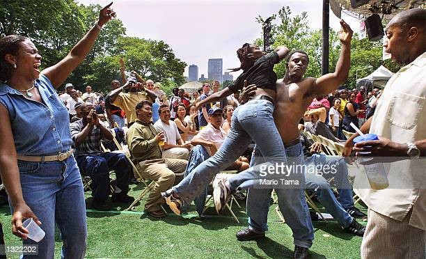 Revelers dance during an Independence Day hiphop concert in Central Park July 4 2001 in New York City
