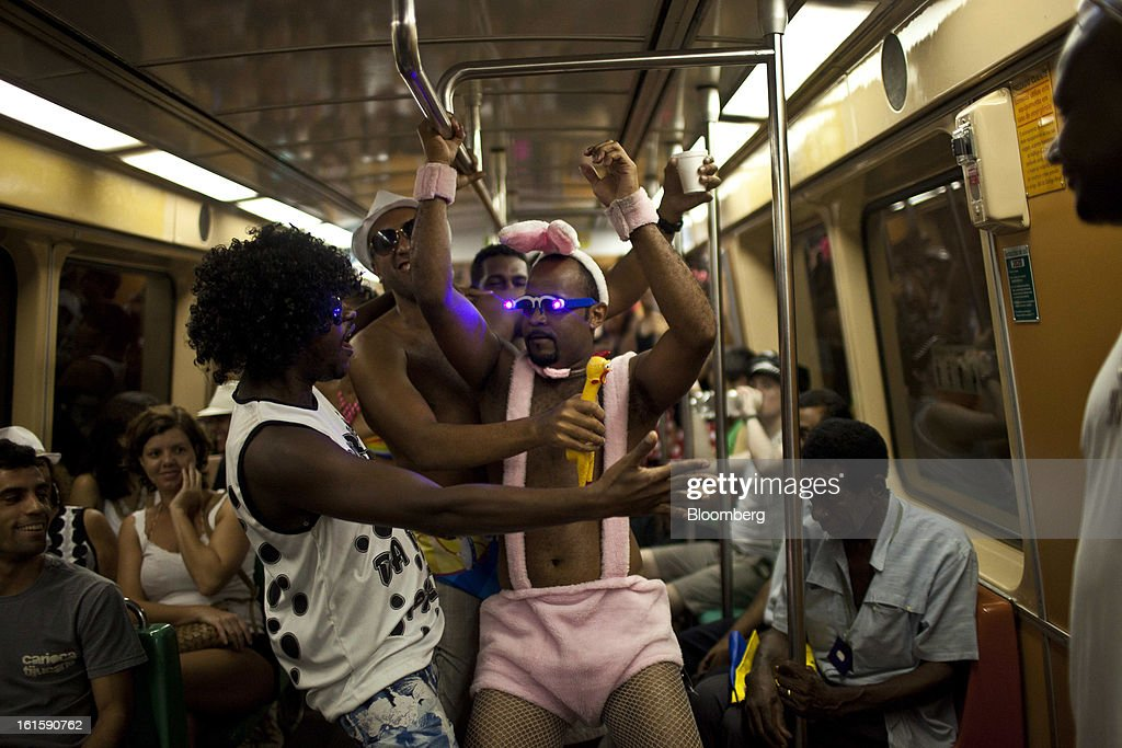 Revelers dance inside a metro train traveling to Carnival celebrations in Rio de Janeiro, Brazil, Saturday, on Feb. 9, 2013. The festivities, which are expected to attract almost 900,000 visitors, precede the start of Lent, which begins with Ash Wednesday on Feb. 13. Photographer: Dado Galdieri/Bloomberg via Getty Images