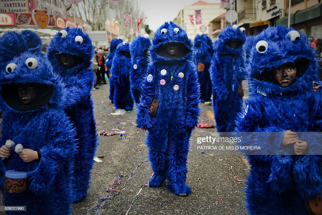 Revelers dressed as Sidney, the cookie monster, participate in the annual carnival parade in Torres Vedras on February 9, 2016. The Torres Vedras Carnival is allegedly the 'most Portuguese' of all the carnivals in the country recognized by the strong political and football satire of the revelers disguises and their floats. / AFP / PATRICIA DE MELO MOREIRA