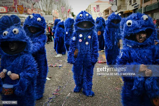 Revelers dressed as Sidney the cookie monster participate in the annual carnival parade in Torres Vedras on February 9 2016 The Torres Vedras...