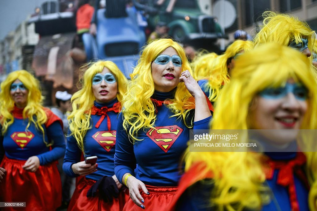 Revelers dressed as Superwoman participate in the annual carnival parade in Torres Vedras on February 9, 2016. The Torres Vedras Carnival is allegedly the 'most Portuguese' of all the carnivals in the country recognized by the strong political and football satire of the revelers disguises and their floats. / AFP / PATRICIA DE MELO MOREIRA