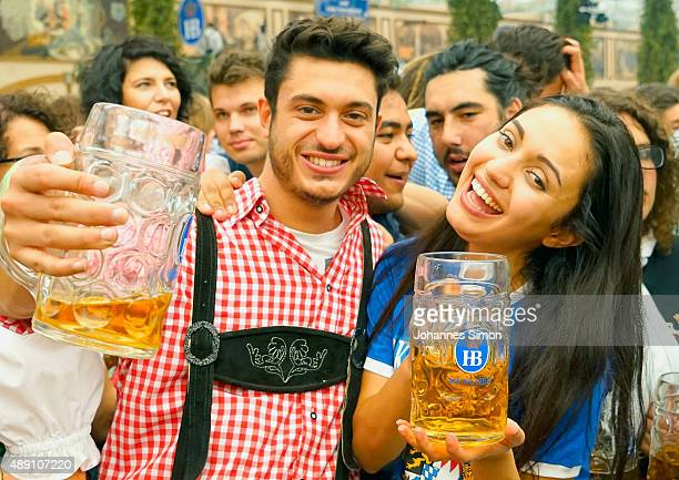 Revelers drink beer at Hofbraeuhaus beer tent on the opening day of the 2015 Oktoberfest on September 19 2015 in Munich Germany The 182nd Oktoberfest...