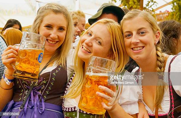 Revelers enjoy drinking beer at Hofbraeuhaus beer tent on the opening day of the 2015 Oktoberfest on September 19 2015 in Munich Germany The 182nd...