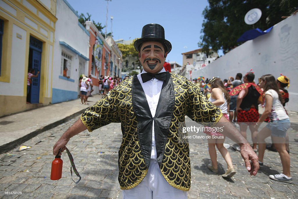 Revelers enjoy during the parade followed by thousands of people during the Carnival on February 11, 2013 in Olinda, Brazil.